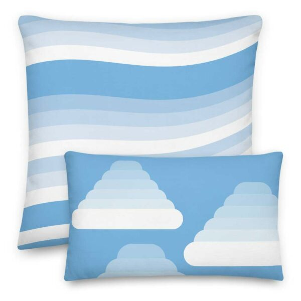 two blue and white pillows with minimalist cloud designs