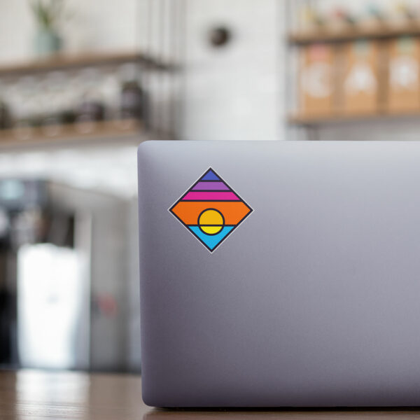 square sticker with a colorful minimalist sunset design on a laptop cover